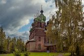 Day View Of The Church Of St. John The Baptist In Yaroslavl In Front Of A Cloudy Sky. poster