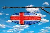 Iceland Flag On Old Signboard. Oval Signboard Colors Flag Iceland Hangs On A Metal Forged Structure. poster