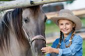 stock photo of cute little girl  - Horse and girl  - JPG