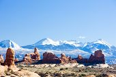 stock photo of turret arch  - Arches National Park with La Sal Mountains - JPG