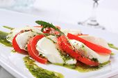 salad caprese with buffalo mozzarella and sliced tomatoes