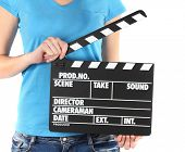 Film Production Clapper Board in Händen, isolated on white