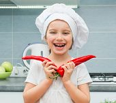 pic of chef cap  - little funny girl in a cap chef in the kitchen with Pepper - JPG