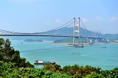stock photo of tsing ma bridge  - Tsing Ma Bridge in Hong Kong over sea in the day with blue sky - JPG