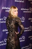 LOS ANGELES - MAR 20:  Beth Behrs arrives at the 21st Annual A Night at Sardi's to Benefit the Alzhe