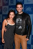 LOS ANGELES - MAR 21:  Zelda Williams, Colin Donnell arrive at the Batman Product Line Launch at the