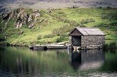 An old stone boathouse on a lake in Snowdonia, North Wales. Nostalgic effect with intentional vignet