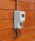 Electricity Supply Meter On Wooden Wall