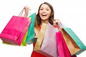 shopping, sale, gifts, christmas, x-mas concept - smiling woman in red dress with colorful shopping