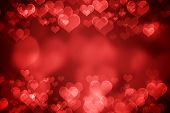 stock photo of holiday symbols  - Red glowing heart shaped bokeh for Valentine - JPG