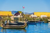 PUNO, PERU - JULY 26: Uros floating islands in the peruvian Andes at Puno Peru on july 26th, 2013. The Uros are a pre-Incan people who live on 42 self-fashioned floating islands in Lake Titicaca