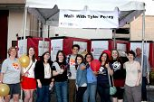 LOS ANGELES - OCT 6:  Tyler Posey with fans and supporters of his LLS team at the Light The Night The Walk to benefit LLS at Sunset-Gower Studios on October 6, 2013 in Los Angeles, CA