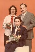 Vintage photo of little boy and his godparents at his First Communion, eighties