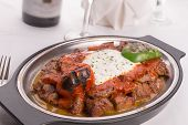 Traditional Turkish Bursa Iskender Kebap Garnished With Grilled Vegetables