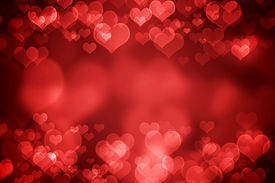 stock photo of february  - Red glowing heart shaped bokeh for Valentine - JPG