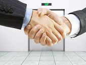 foto of elevators  - business handshake on a elevator background - JPG