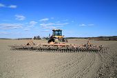 Caterpillar Challenger Tracked Tractor And Potila Seedbed Cultivator On Spring Field