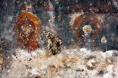 Saints in ancient fresco background