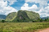 Mountains at the Vinales valley in Cuba with puffy white clouds on a blue sky