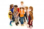 Children stand around crying girl. Isolated over white.