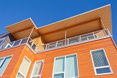 Bright Timber Clad Condo Building Exterior Detail
