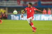 VIENNA,  AUSTRIA - JUNE  7 David Alaba (#8 Austria) kicks the ball during the world cup qualifier ga