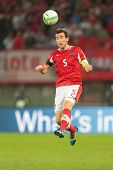 VIENNA,  AUSTRIA - JUNE  7  Christian Fuchs (#5 Austria) heads the ball during the world cup qualifi