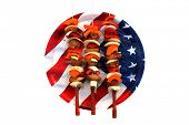 Genuine American Chicken, Onion, and Bell Pepper Shish Kebab on Metal Skewers with Wooden handles on