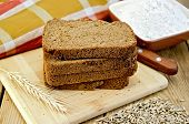 Rye Bread With Flour And Grain On Board