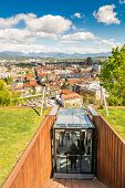 stock photo of descending  - Funicular descending with a panoramic view of a city Ljubljana Slovenia - JPG
