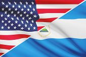 Series Of Ruffled Flags. Usa And Republic Of Nicaragua.
