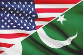Series Of Ruffled Flags. Usa And Islamic Republic Of Pakistan.