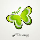 Shiny beautiful green butterfly created by green leaves on grey background. Concept for World Enviro