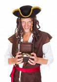 picture of buccaneer  - Happy Young Pirate Holding Treasure Box Over White Background - JPG