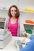 Young Female Cashier With Cash Register