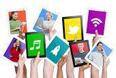 Variation of hands holding digital tablets with social media concepts.