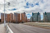 View of multi lane road and contemporary residential building in Valencia, Spain.