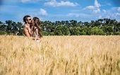 Couple In Love Kissing In Argentinean Countryside Field