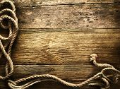 Ship ropes on a wooden background