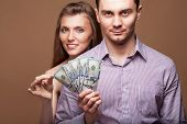 Loving Couple Are Holding A Large Sum Of Money. Business Concept. Family Budget.