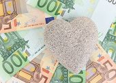 Love for money concept. Heart on European currency