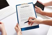 Hands holding a business contract