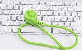 Green power cord on keyboard