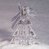Glass Christmas Tree Decorated With Silver Bow