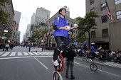 Gym Dandies juggle in unicycles