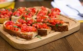 Bruschetta With Sweet Tomatoes And Basil