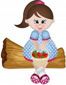 Little girl sitting with basket strawberries