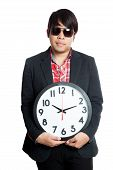 Asian Man Hold A Clock In Font Of Him