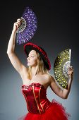 Woman dancing with fans in arts concept