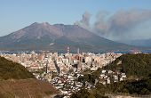 Kagoshima, Japan with Mount Sakurajima erupting